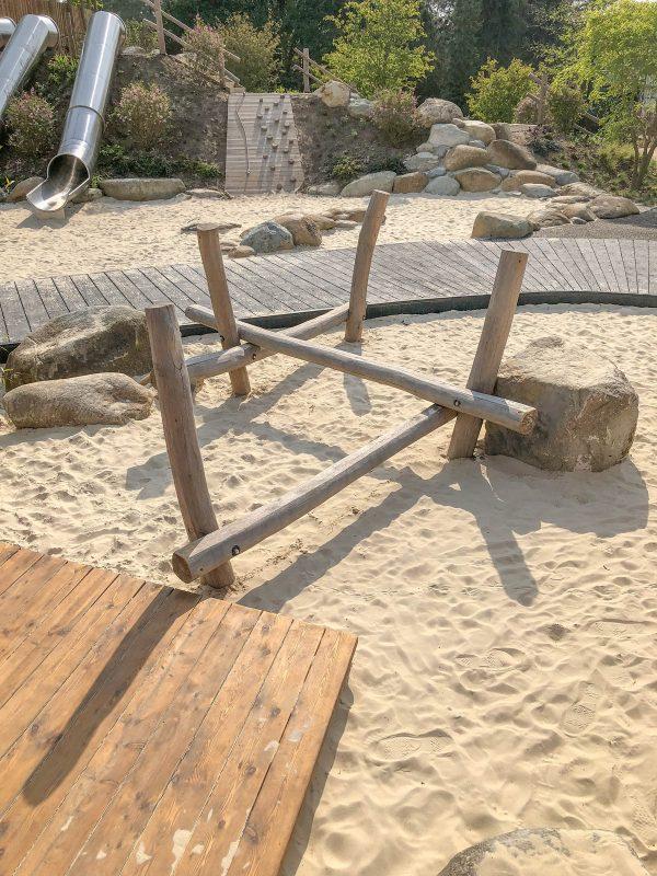 natural playground equipment stilted balance beam